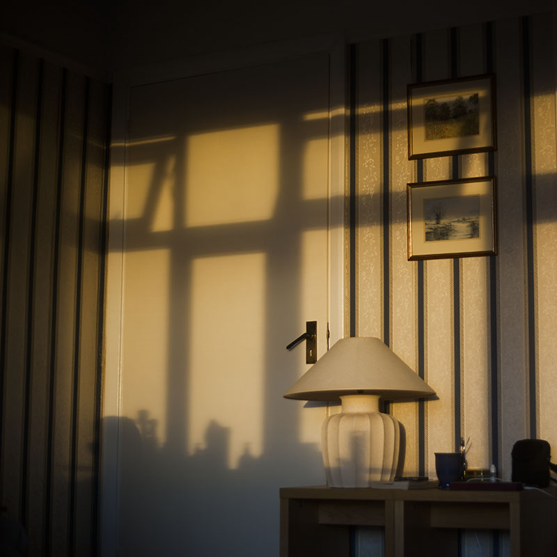 sun-setting-inside-flat-shadows-on-wall-lamp-door